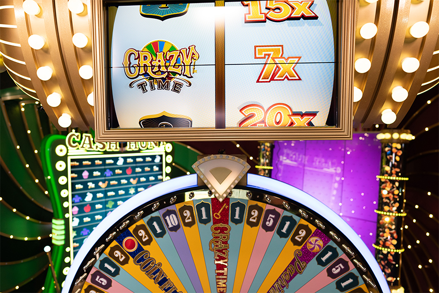 The Money Wheel and Top Slot Spin at the Same Time